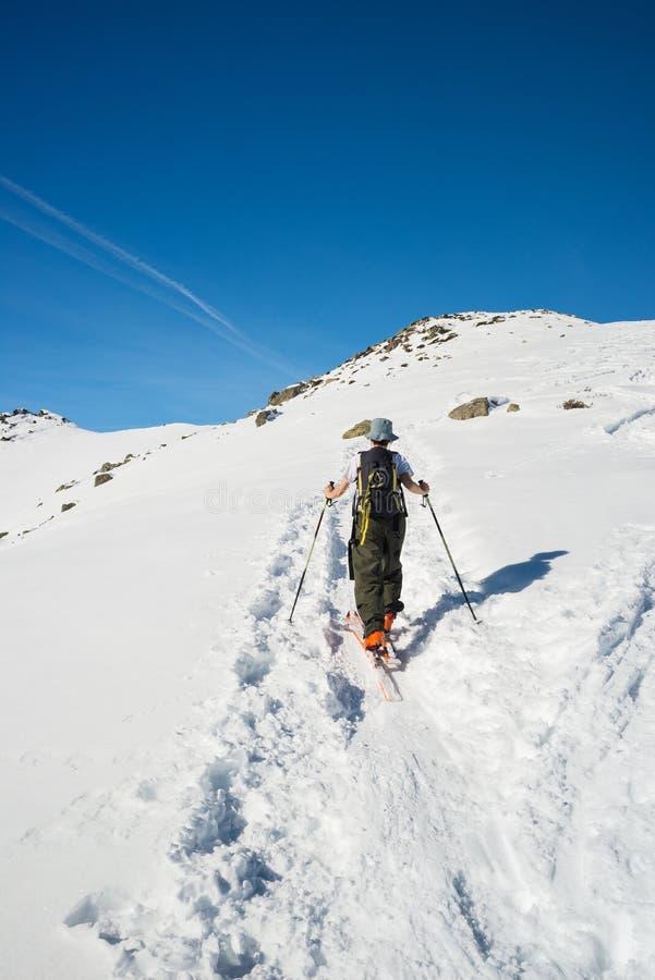 Alpine ski touring towards the summit stock photo