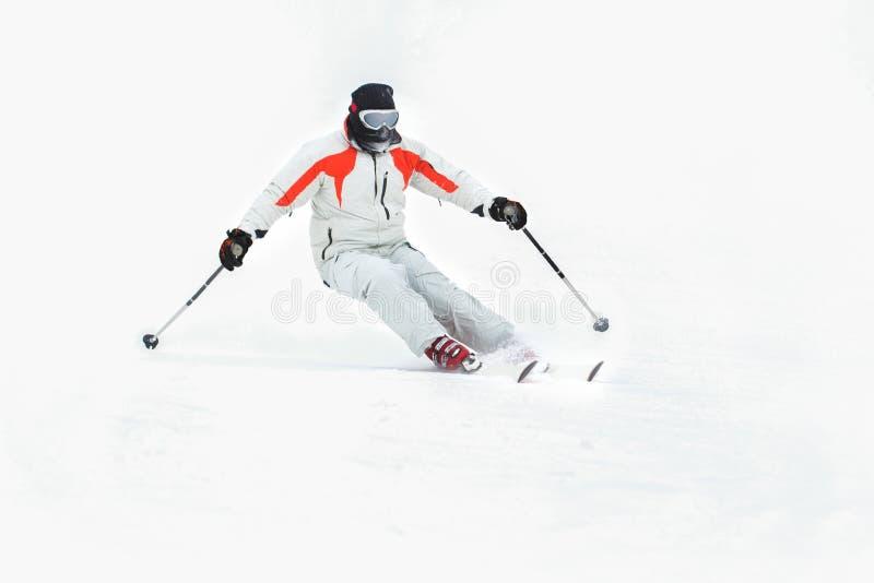 Alpine skier skiing downhill royalty free stock image