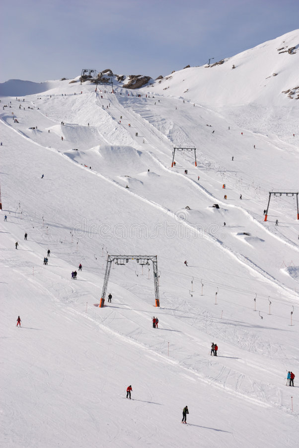 Alpine skiing area drag lifts royalty free stock photography