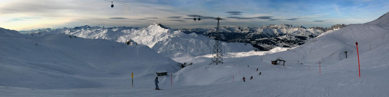 Alpine skiing with a splash of sun royalty free stock images