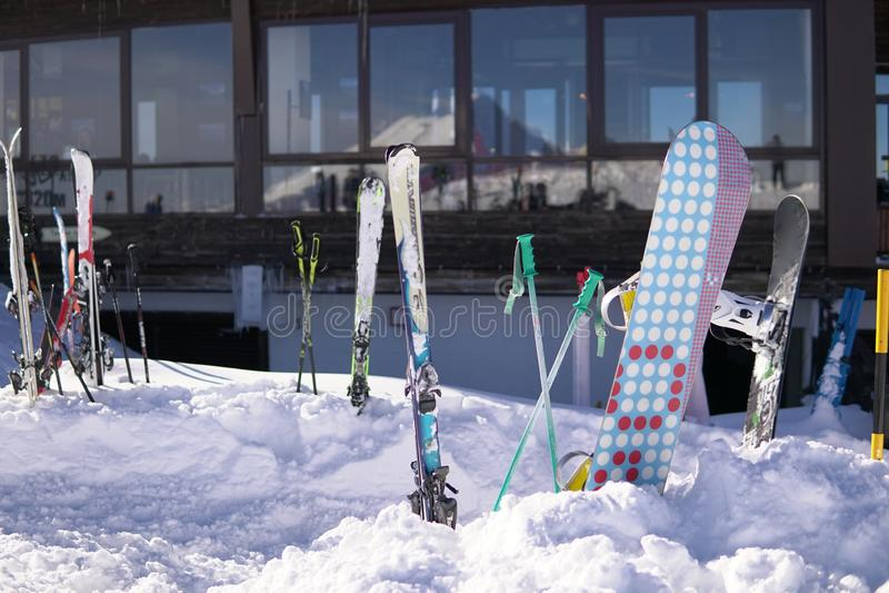 Alpine snowboards winter sports resort blue sky winter ski resort. Snow mountains, blue sky winter ski resort stock photos