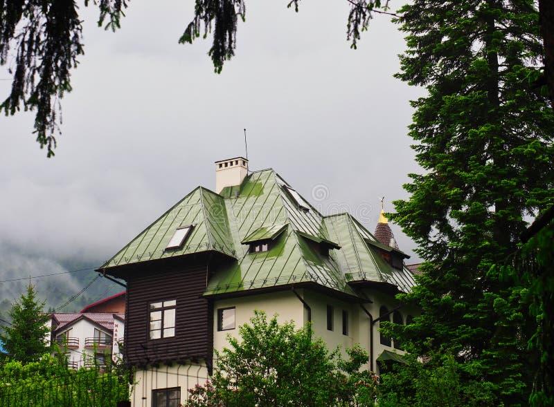 Alpine Style House in Rain, Carpathian Mountains, Romania stock photo