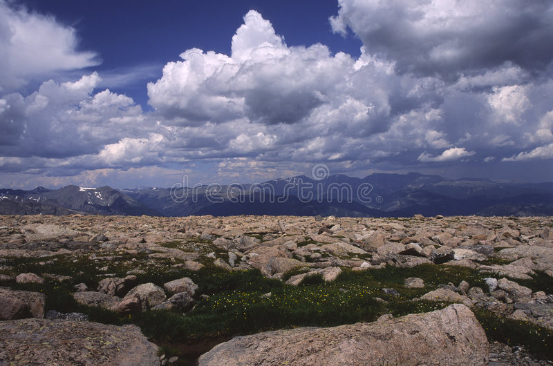 Alpine terrain in Colorado Rocky Mountains. Alpine boulder field with storm clouds overhead in Colorado Rocky mountains royalty free stock photography