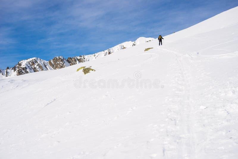 Alpine touring towards the summit stock photos