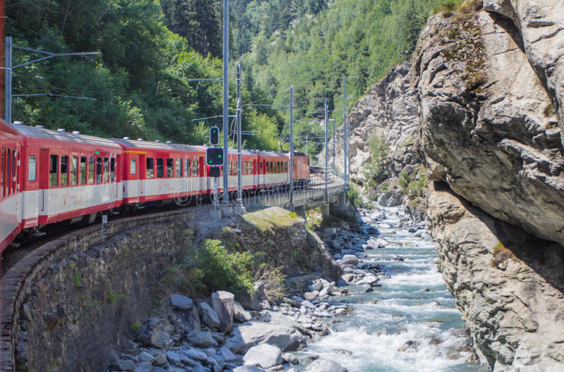 Alpine train in the Swiss Alps. Switzerland, summer 2013 royalty free stock photos