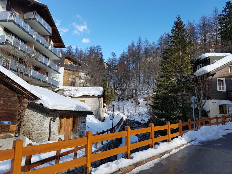Alpine Village in cold winter. Alpine Village Alpine Village in cold winter. Shalet, forest and mountains royalty free stock photos