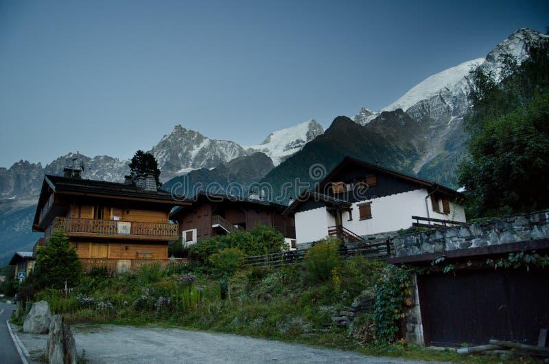 Alpine village at dusk royalty free stock photos