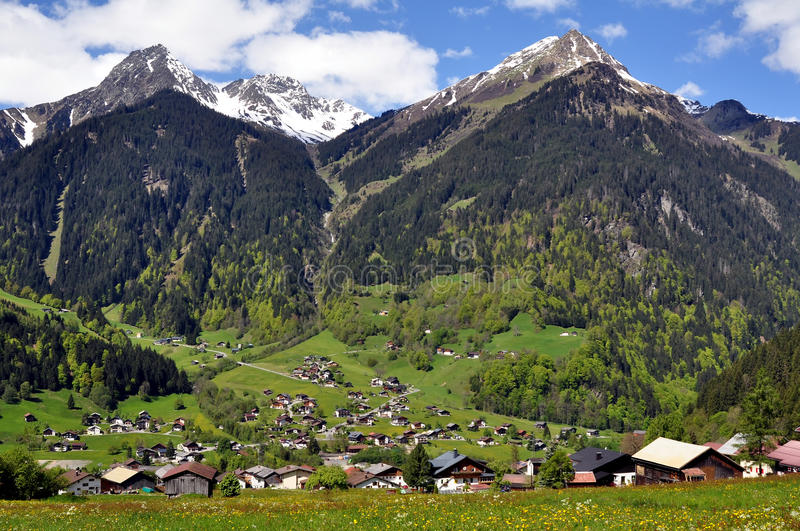 Alpine_village_and_mountains Royalty Free Stock Photo