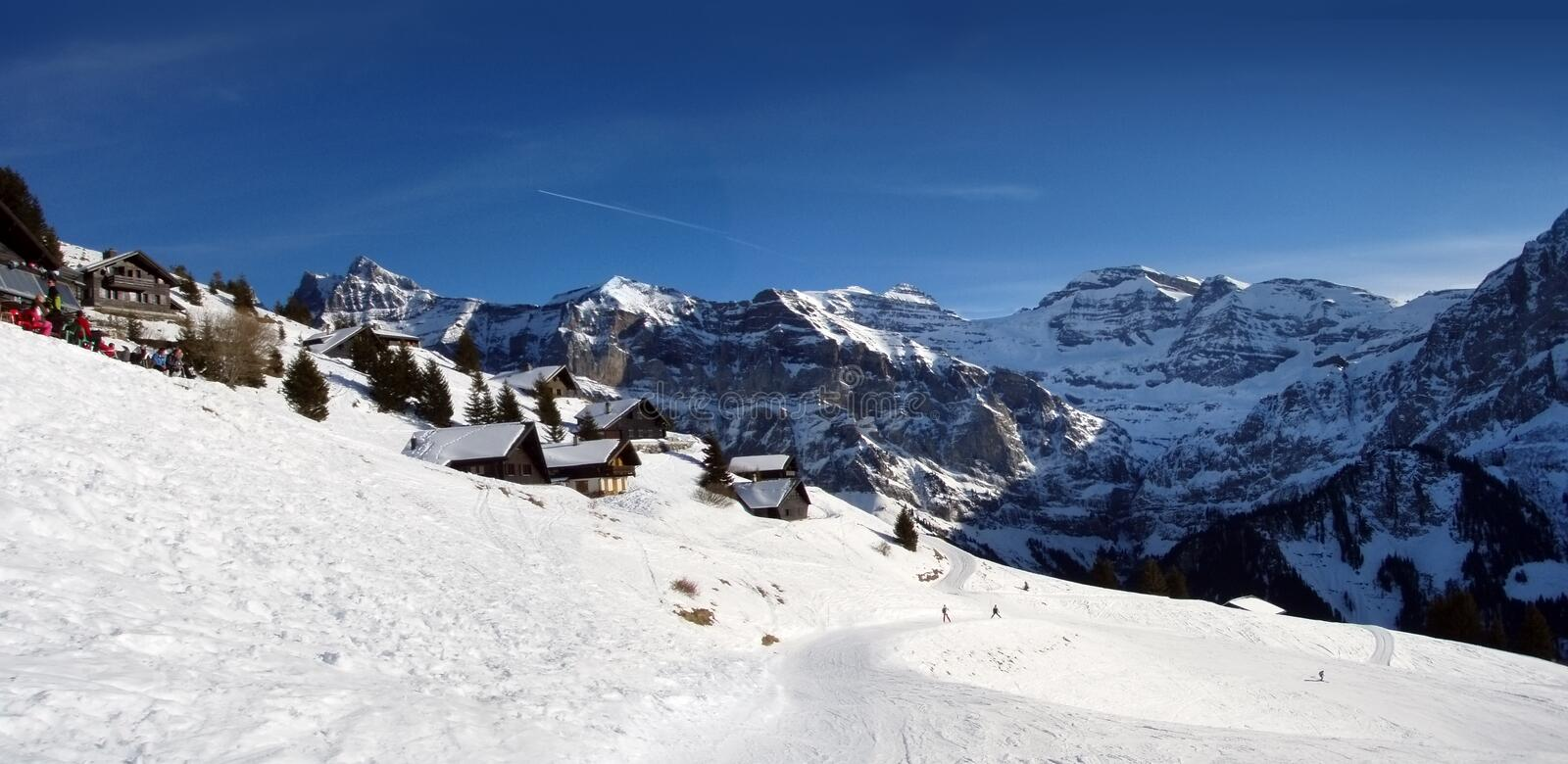Alpine winter panorama. Winter view of swiss alpines chalets, Champery, January 2008 royalty free stock photos