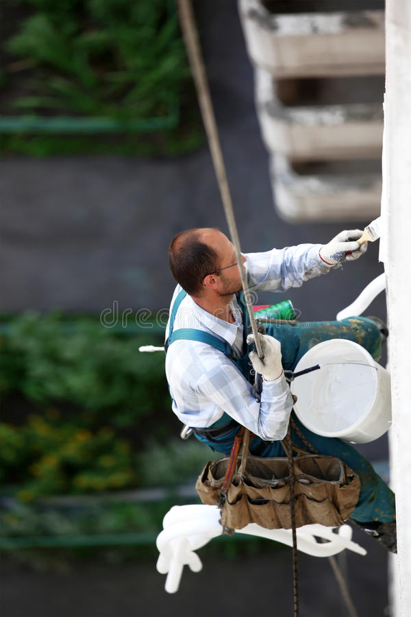 Alpinist worker. Repair the building stock photography