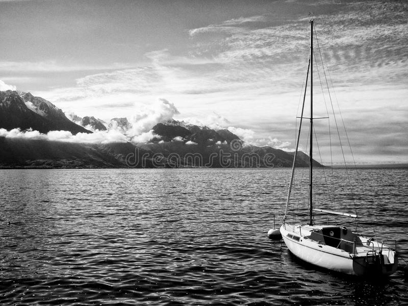 Download Alps stock image. Image of black, alps, snow, lake, clouds - 21750939