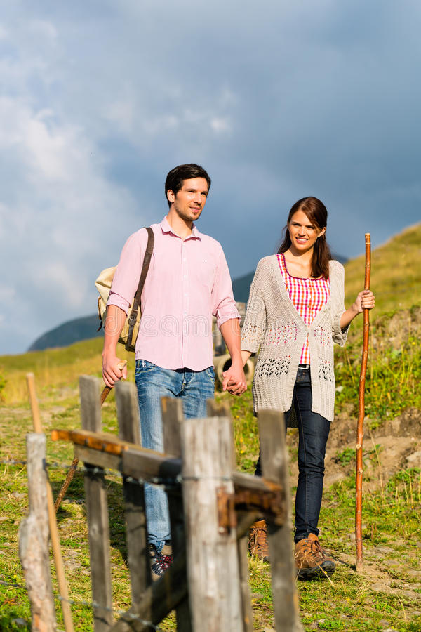 Alps - Couple hiking in Bavarian mountains royalty free stock photo