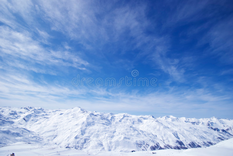 The Alps is the great mountain range systems of Eu. Great mountain range system against the Blue sky with clouds stock images