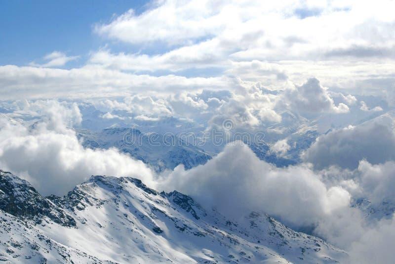 Alps mountain peak. Snow, clouds, Extreme Ski sport royalty free stock photography