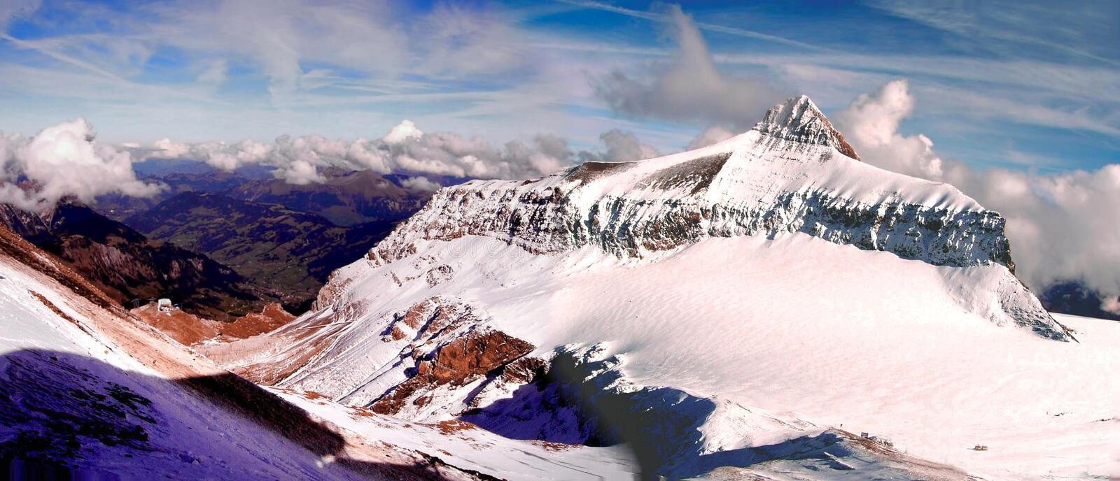 Alps 3000 mountain peak panaromoc. A panoramic view of alps peak 3000 in Switzerland from the top royalty free stock image