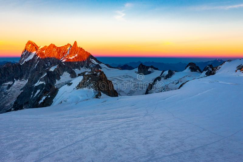 Alps mountains peaks sunset landscape, Mont Blanc massif. Dent du Geant Grandes Jorasses sunlit beautiful mountains  ridge peaks sunset evening view, Alps range royalty free stock image