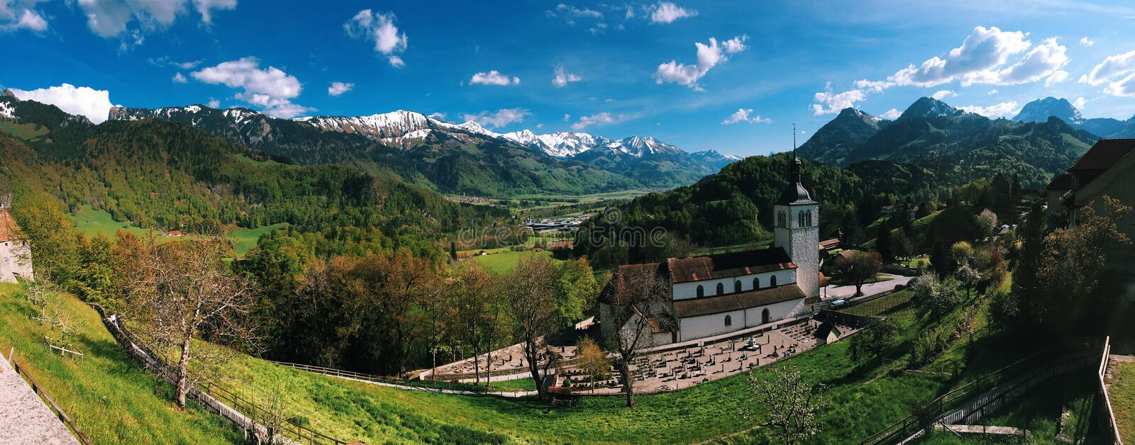Alps panorama with Church stock photography