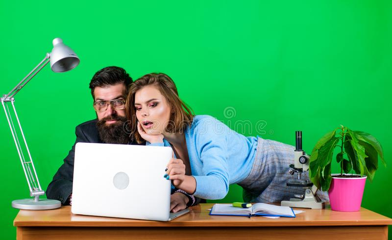 We already have great results. secretary with boss at workplace. woman and man work in office at laptop. business couple. We already have great results stock image