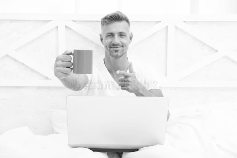 Already at work. Digital marketing. Remote access. Hipster bearded guy pajamas freelance worker relaxing at home. Remote royalty free stock image