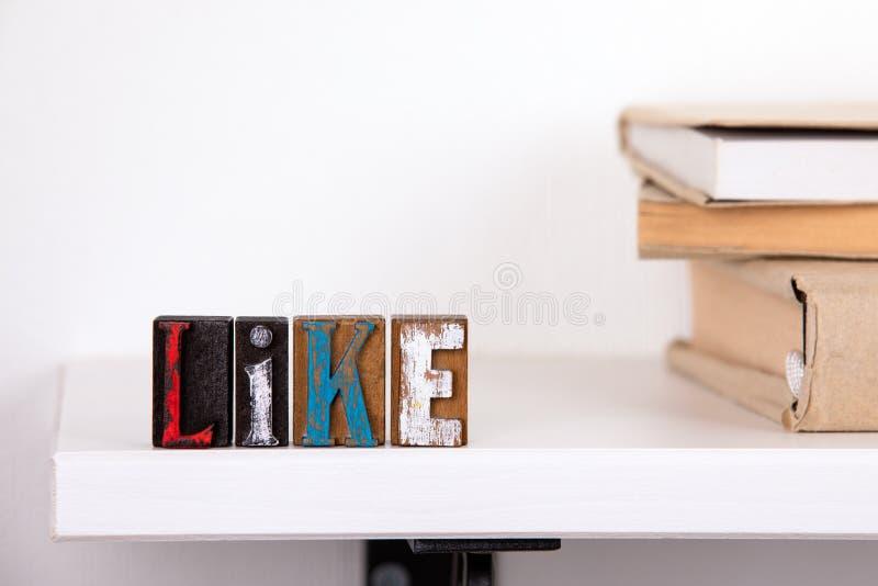 Als woord van gekleurde houten brieven royalty-vrije stock foto