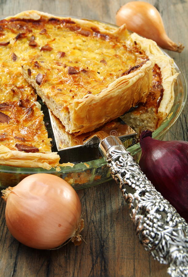 Alsatian onion pie with ham. royalty free stock photography