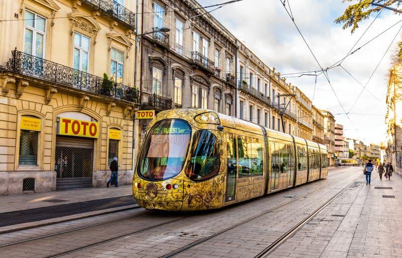 Alstom Citadis 302 tram in Montpellier, France. MONTPELLIER, FRANCE - JANUARY 05: Alstom Citadis 302 tram on January 5, 2014 in Montpellier, France. The royalty free stock image