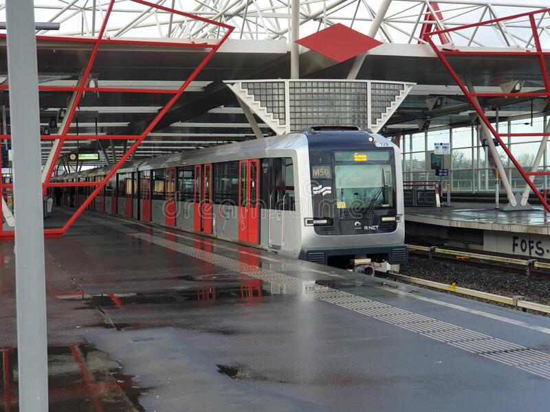 Alstom Metropolis metro street car on line 50 at th amsterdam network at station Duivendrecht royalty free stock photography