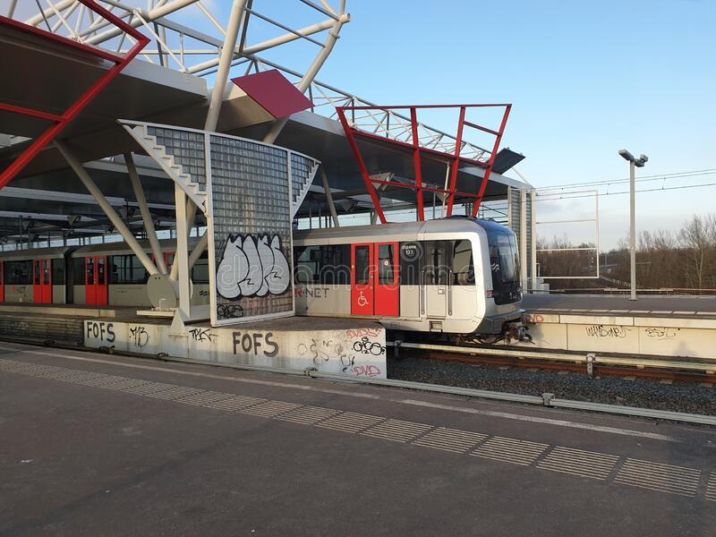 Alstom Metropolis metro street car on line 50 at th amsterdam network at station Duivendrecht stock photography