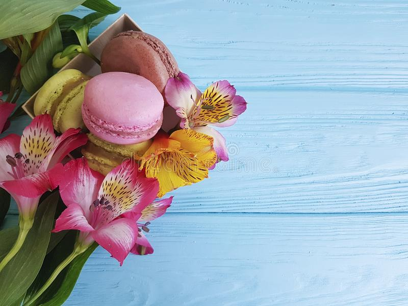 Alstroemeria on a pink wooden design cake, dessert royalty free stock images