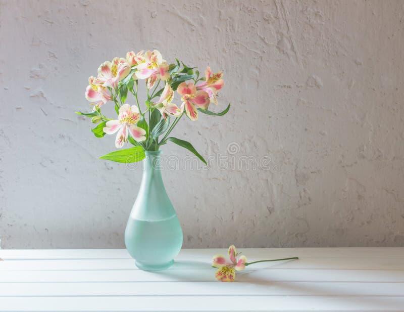 Alstroemeria in vase on white background royalty free stock photos