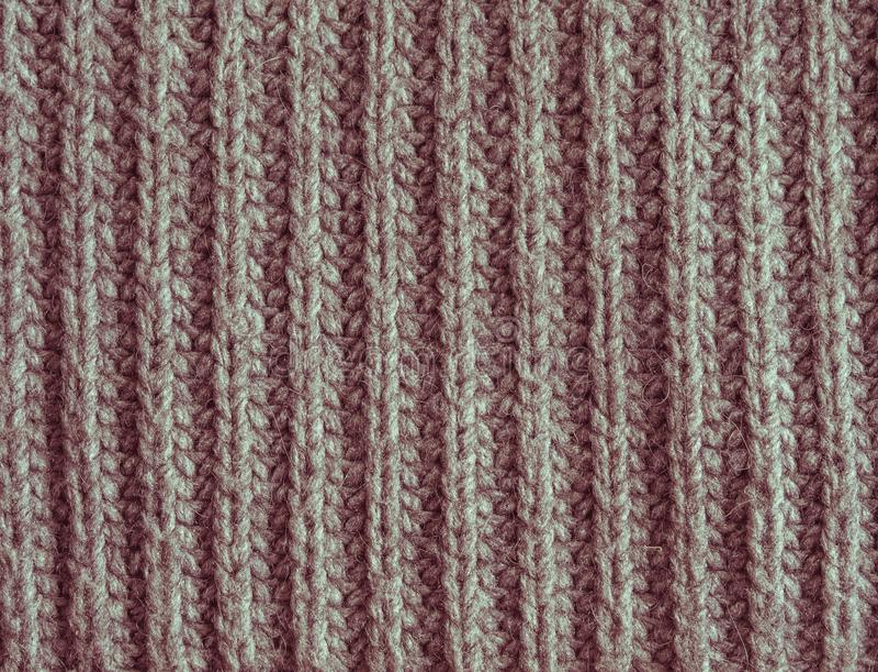 Alt verblassen Sie rot, oder die rosa gestrickte Wolle masert abstrakten Hintergrund stockfotos