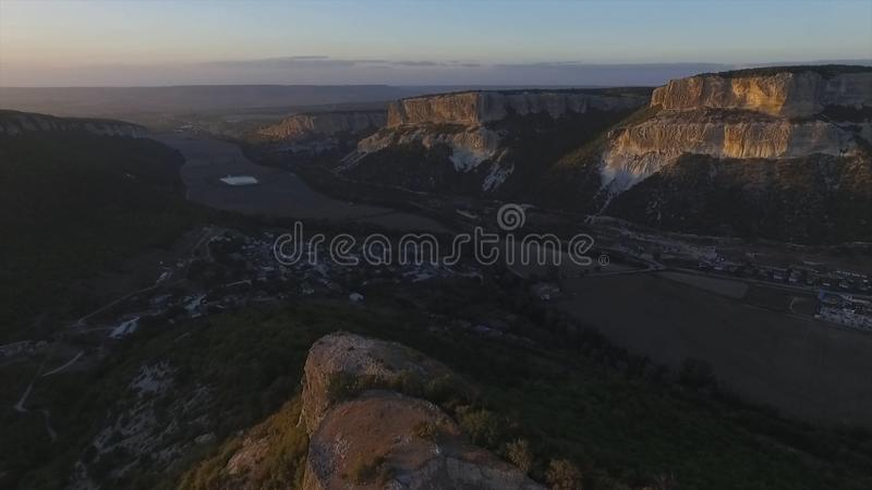 Altai mountains removed from the drone. Shot. Aerial view to landscape of green valley flooded with light with lush stock image