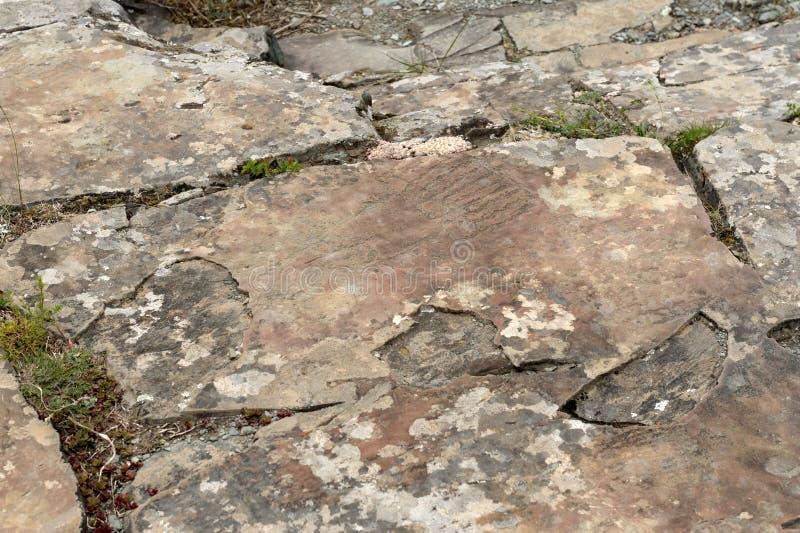 Rock petroglyphs in the tract Kalbak-Tash. ALTAI REPUBLIC, RUSSIA - JUNE 8, 2018: Rock petroglyphs in the tract Kalbak-Tash. Petroglyphs of different historical stock images