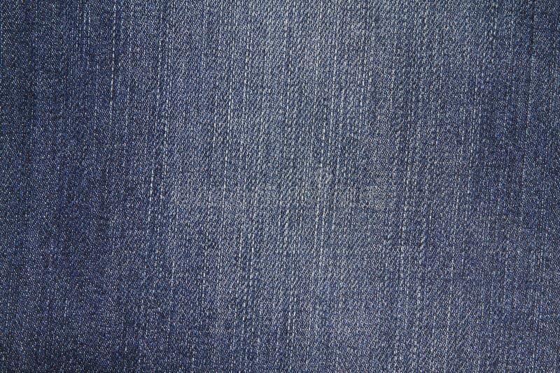 Altamente la risoluzione ha dettagliato la struttura dei jeans blu astratti del denim immagine stock libera da diritti