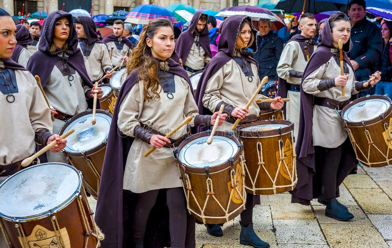 Musical group in medieval costume parade through the streets of Altamura. Altamura, Italy - April 25, 2016: musical group in medieval costume parade through the stock images