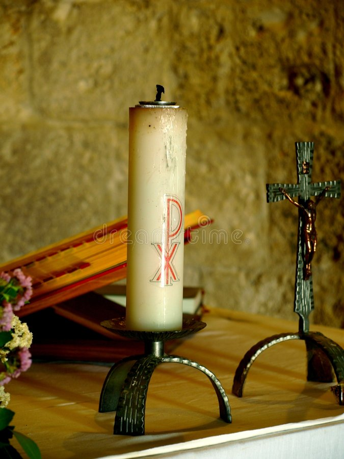 Altar. A suggestive shot of an altar with Cross, large candle and missal in the ancient Montesiepi hermitage stock photo