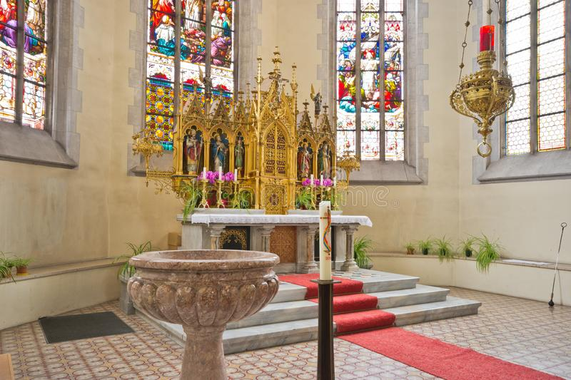 Altar and baptismal font in catholic church royalty free stock image