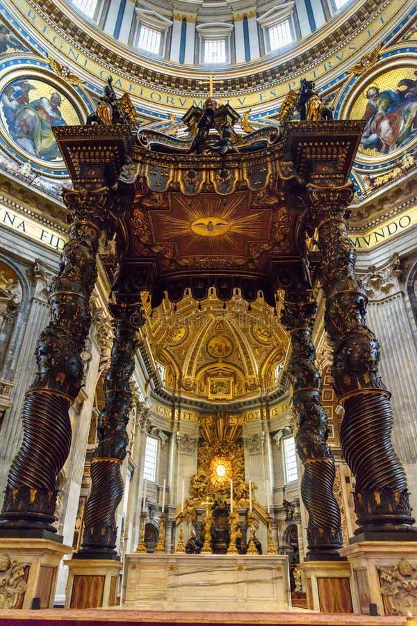 Altar with Bernini`s baldacchino. Interior of Saint Peter`s Basilica in Vatican. Vatican city, Vatican - October 05, 2018: Altar with Bernini`s baldacchino stock images