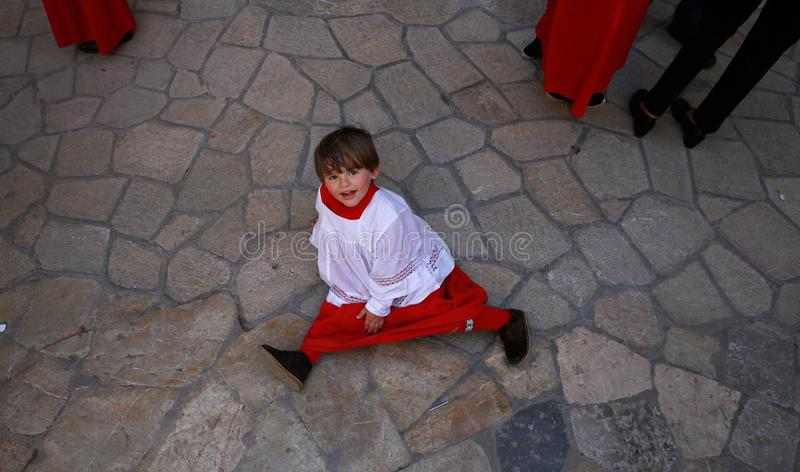 Altar boy during holy week celebrations in the island of mallorca stock photos
