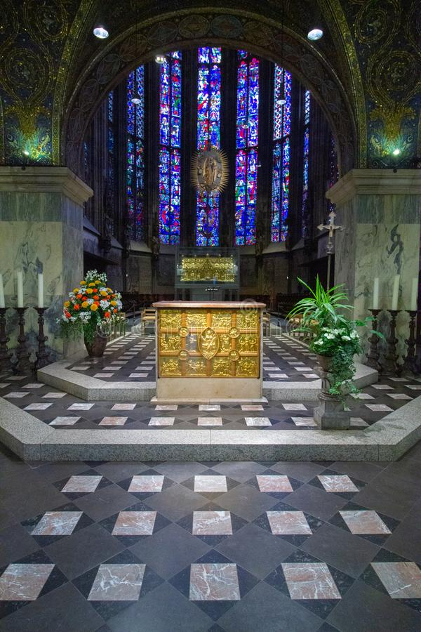 Altar in church and in the background stained glass windows. Inside view of dome Aachener Dom. Roman Catholic church in Aachen, western Germany, It is claimed as stock photography