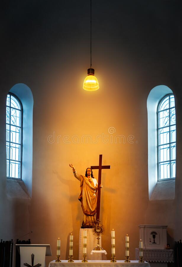 Altar in Church of Holy Trinity in Ukmerge. Altar and lantern in Church of Holy Trinity in Ukmerge. Lithuania royalty free stock photos