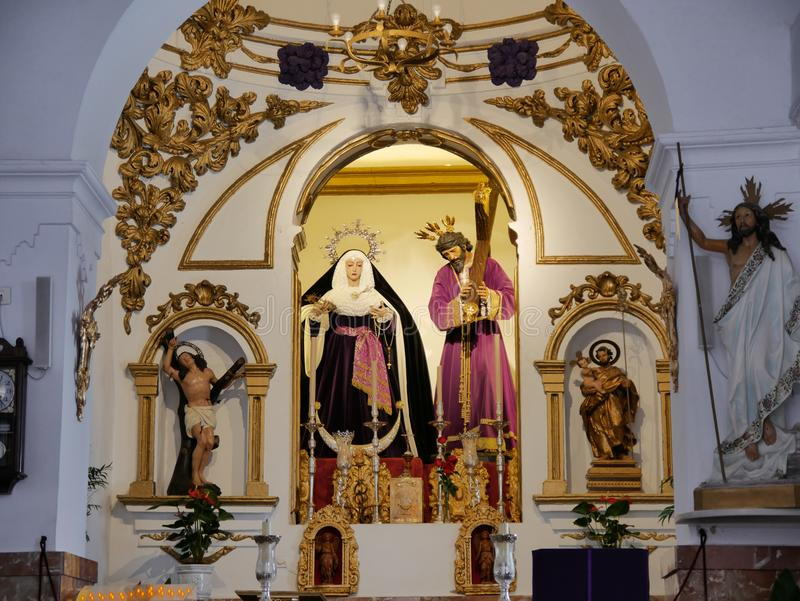 Altar in church in Mijas one of the most beautiful `white` villages of the Southern Spain area called Andalucia. stock photos
