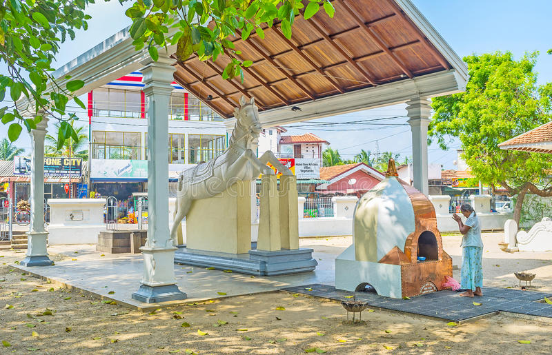 The altar at the horse statue. MADAMPE, SRI LANKA - NOVEMBER 25, 2016: Thaniwalla Devalaya is also famous as the Horse Temple, the scenic statue of the white royalty free stock photos