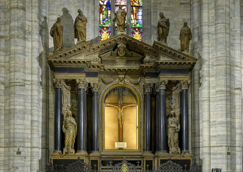 Altar with Jesus on the Cross inside the Milan Cathedral, the cathedral church of Milan, Lombardy, Italy. royalty free stock image
