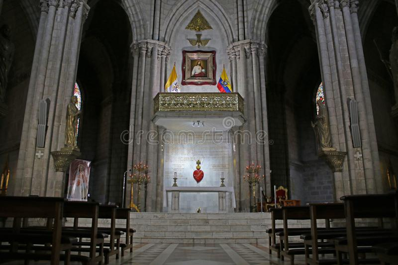 Altar in a neo gothic catolic church or basilica of the national vow with two ecuadorian flags and two pillars. Altar in a neo gothic catolic church or basilica royalty free stock image