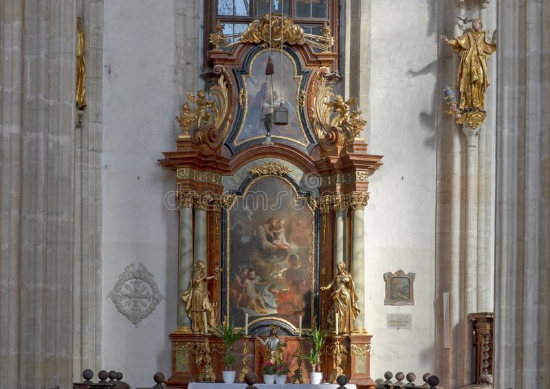 Altar northern nave wall with painting Saint Jospeh, Interior Piarist Church, Krems on the Danube, Austria. Pictured is the nave on the north wall with a royalty free stock photo