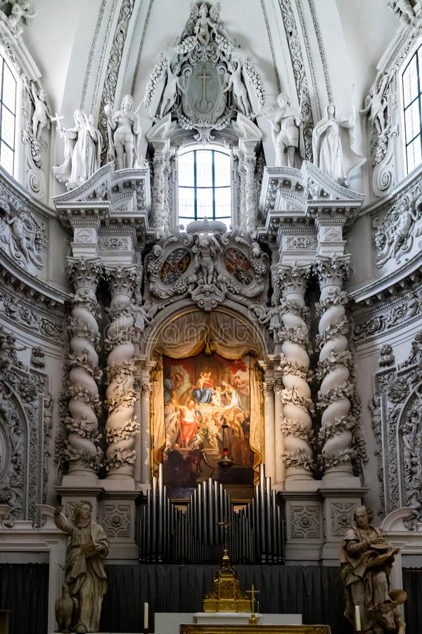 Altar piece painting and organ pipes stock photos