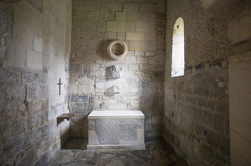 Altar in Saxon Church Bradford on Avon. St Laurence`s church Bradford on Avon is one of a few Anglo Saxon churches which has survived without major alterations royalty free stock image