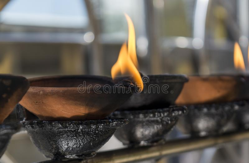 Altar with small burning wooden cups stock images
