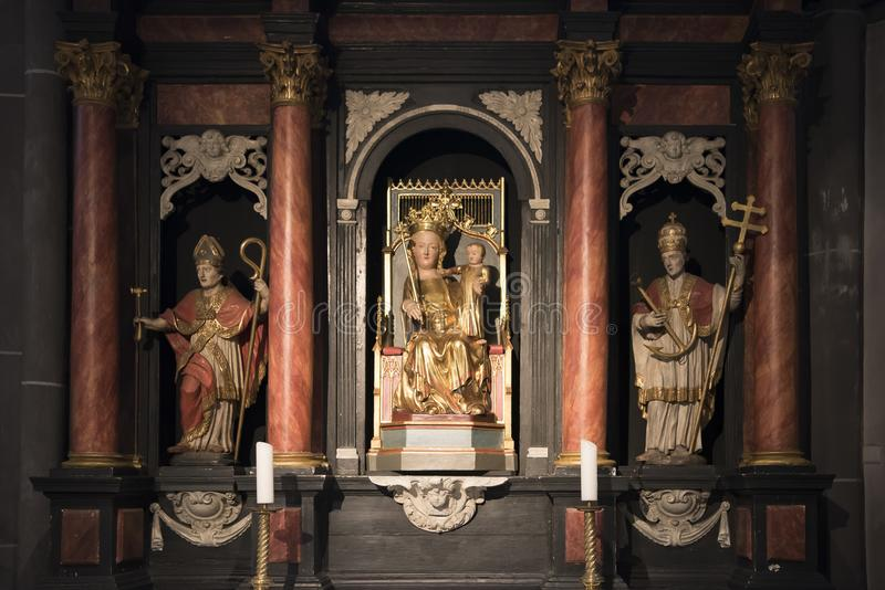 Medieval altar with Statue St. Mary and child Jesus stock photography